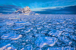 Disrupted pack ice in the front of the Sierra DuFief on the southern part of Wiencke island, Gerlache Strait, Palmer Archipelago, Antarctica - Klein & Hubert