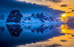 Lemaire Channel at sunset between Booth Island and Cape Renard on Kiev peninsula, Graham Land, Antarctica  -  Klein & Hubert