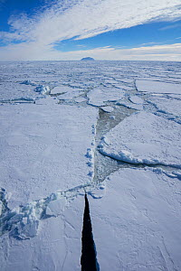 Sea ice, near Mount Terror and Mount Erebus Ross Sea, Antarctica.  Photographed for The Freshwater Project  -  Michel  Roggo