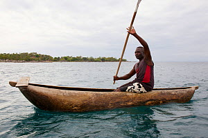 Fisherman in traditional dugout canoe, Lake Malawi,  Malawi, November 2015. Photographed for The Freshwater Project - Michel  Roggo