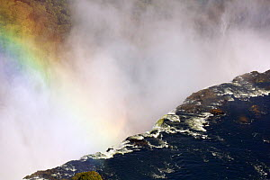 Aerial view of Victoria Falls with rainbow, Zambezi River at the border of Zimbabwe and Zambia, Mosi-oa-Tunya / Victoria Falls UNESCO World Heritage Site. Photographed for The Freshwater Project in Ju...  -  Michel  Roggo