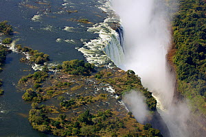 Aerial view of Victoria Falls Waterfall,  Zambezi River at the border of Zimbabwe and Zambia, Mosi-oa-Tunya / Victoria Falls UNESCO World Heritage Site. Photographed for The Freshwater Project in July...  -  Michel  Roggo