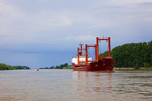 Ship  on the main channel of the Danube river, the Bratul Sulina, at Crisan, Danube Delta Biosphere Reserve, UNESCO World Heritage Site, May 2014 . Photographed for The Freshwater Project  -  Michel  Roggo