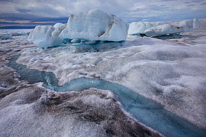 Meltwater channels flowing into meltwater lake, with collapsed ice cover Sermeq Kujalleq Glacier, Ilulissat Icefjord UNESCO World Heritage Site. Sermersuaq / Greenland ice sheet, Greenland, August. Ph...  -  Michel  Roggo