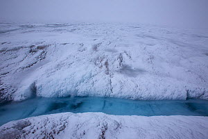 Snow storm at meltwater lake,  Sermeq Kujalleq Glacier, close to the Kangia River, Ilulissat Icefjord UNESCO World Heritage Site, Sermersuaq / Greenland ice sheet, Greenland, August 2014. Photographed...  -  Michel  Roggo