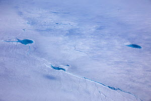 Aerial view of meltwater lake on the ice cap east of Kangerlussuaq, Sermersuaq / Greenland ice sheet, Greenland, August 2014. Photographed for the Freshwater Project. - Michel  Roggo