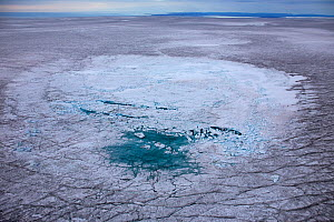 Aerial view of meltwater lake with collapsed ice cover on ice cap north-east of Sermeq Kujalleq Glacier, Ilulissat Icefjord UNESCO World Heritage Site, Sermersuaq / Greenland ice sheet, Greenland, Aug... - Michel  Roggo