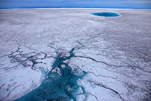 Aerial view of meltwater channels and meltwater lake on the ice cap north-east of Sermeq Kujalleq Glacier, Ilulissat Icefjord UNESCO World Heritage Site,  Sermersuaq / Greenland ice sheet, Greenland,...  -  Michel  Roggo