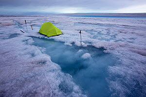 Base camp at meltwater lake on ice cap north-east of Sermeq Kujalleq Glacier,   Ilulissat Icefjord UNESCO World Heritage Site, Sermersuaq / Greenland ice sheet, Greenland. August 2014. Photographed fo... - Michel  Roggo
