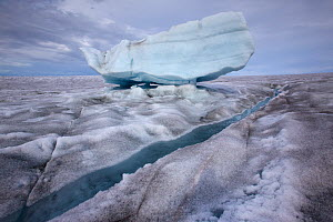 Meltwater channels flowing meltwater lake on the ice cap north-east of Sermeq Kujalleq Glacier, Ilulissat Icefjord UNESCO World Heritage Site, Greenland. August 2014. Photographed for the Freshwater P... - Michel  Roggo