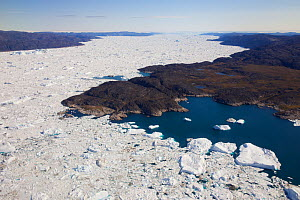 Aerial view of the Ilulissat Icefjord, with the Sermeq Kujalleq Glacier or Jakobshavn Isbrae entering the sea, near  Ilulissat Icefjord UNESCO World Heritage Site, Greenland. August 2014. Photographed...  -  Michel  Roggo