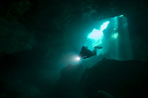 Diver in Cenote Cristalino, Quintana Roo, Yucatan Peninsula, Mexico.  May. Photographed for The Freshwater Project - Michel  Roggo