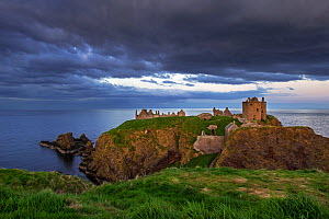 Dark clouds above Dunnottar Castle, ruined medieval fortress near Stonehaven on cliff along the North Sea coast, Aberdeenshire, Scotland, UK, May 2017  -  Philippe Clement