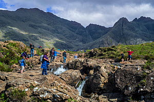 Large group of tourists visiting the Fairy Pools, succession of waterfalls in Glen Brittle on the Isle of Skye,  Scotland, UK, June 2017 - Philippe Clement