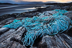 Discarded plastic rope and commercial fishing netting washed up on shore at Luskentyre, South West Harris, Western Isles / Outer Hebrides, Scotland, May 2016  -  Laurie  Campbell