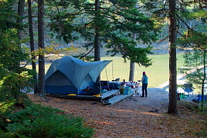 Camping on Mount Desert Island, near Acadia National Park, Maine, USA. October 2013.  Model released. - Tim  Laman