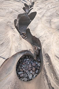 Grinding stones and pebbles crack of the river bed fprmed by swirling water, Purnululu National Park, UNESCO World Heritage Site,Kimberley, Western Australia. June 2016. - Jurgen Freund