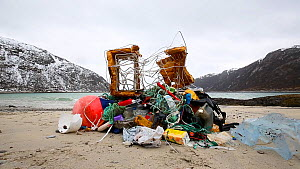 Time lapse of people emptying plastic bags full of marine litter to show what has been collected during a beach clean, Tussoya, Troms, Norway, 2017.  -  Espen Bergersen