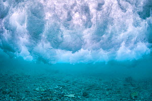 Wave breaking over the rubble zone close to the reef crest of a coral reef. Baa Atoll, Maldives. Indian Ocean.  -  Alex Mustard