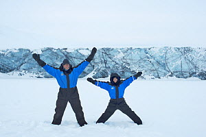 Photographer Sandra Bartocha with Werner Bollmann in the snow. Svalbard, Norway, March 2014. - Sandra Bartocha