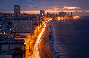 Malecon promenade,  at dusk on stormy evening, Havana, Cuba. May 2009. - Eladio Fernandez