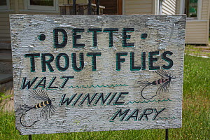 Family run fly fishing shop sign for Dette Trout Flies, Beaverkill River, New York, USA, May. - Phil Savoie