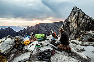 Cameraman Richard Kirby capturing timelapse near the summit of Mount Kinabalu, Borneo. May 2013. - Paul Williams