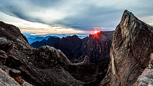 Sunrise as seen over Low's Gully and ugly sister peak, from the base of Low's peak (Approx 4000 metres) Mount Kinabalu. Borneo, May 2013.  -  Paul Williams