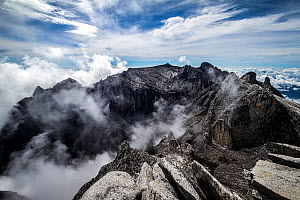 Clouds rolling into Low's Gully, as seen from the summit of Mount Kinabalu,  (4,095m) Borneo, May 2013. - Paul Williams