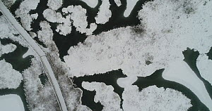 Aerial shot of lake covered by the first snow, Bindingsvann, Akershus, November Norway, November 2017. - Pal Hermansen