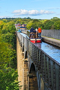 Canal barges crossing the Pont-Cysyllte aqueduct heading north over the River Dee near Trevor in the Vale of Llangollen North Wales UK September 2017 - Alan  Williams