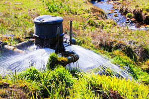 House with home made small scale hydro turbine to provide electricity,  Isle of Eigg, Scotland, UK, May 2012. - Ashley Cooper