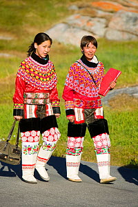 Inuit women wearing traditional Greenlandic national costume or Kalaallisuut, Ilulissat on Greenland. The costume consists of seal skin boots (Unnaat) bead necklaces (Nuilaqutit) and seal skin trouser... - Ashley Cooper