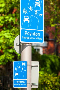Sign in Poynton village, Cheshire which has recently undertaken a shared space road experiment, where pedestrians and vehicles share the same space. England, UK, May 2012. - Ashley Cooper