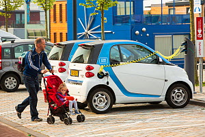 Electric Smart car at a charging station for electric cars in Ijburg, Amsterdam, Netherlands, May 2013. - Ashley Cooper