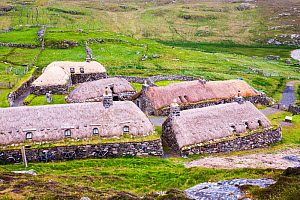 The Black House village at Garenin near Carloway, Isle of Lewis, Outer Hebrides, Scotland, UK. June 2015.  These ancient traditional houses have been preserved, after they were abandoned finally in th...  -  Ashley Cooper