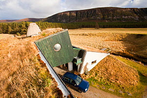 Environmentally friendly house that was built in the 1970's but still exceeds green build regulation today, at Feshiebridge, Cairngorm, Scotland, UK,  March 2012.  -  Ashley Cooper