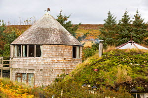 Croft powered by wind and solar power in remote off grid community. Scoraig,  Scotland, October 2013. - Ashley Cooper