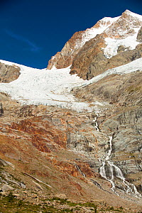 The rapidly retreating glaciers of Glacier De La Lex Blanche and  Glacier du Petit Mont Blanc on the Aiguille De Tre La Tete in the Italian Alps on the Tour Du Mont Blanc. - Ashley Cooper