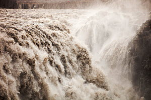 Dettifoss waterfall, the largest waterfall in Europe by volume. It is 100 metres wide and takes meltwater in the river Jokulsa a Fjollum from the Vatnajokull ice sheet. Iceland. September.  -  Ashley Cooper