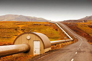 A pipeline taking geothermally heated hot water from Hellisheidi geothermal power station in Hengill, to Reykjavik, Iceland. September 2010.  -  Ashley Cooper