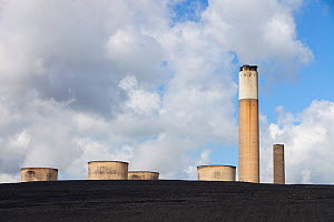 Ratcliffe on Soar coal fired power station near Nottingham, UK, showing the cooling towers and chimney rearing up from a mountain of coal  -  Ashley Cooper