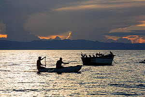 Fisherman in a traditional dug out canoe at Cape Maclear, on Lake Malawi, Malawi, Africa. - Ashley Cooper