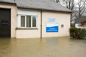 Ambleside Ambulance Station surrounded by flood waters by the banks of the River Rothay in Ambleside, in the Lake District on Saturday 5th December 2015, during torrential rain from storm Desmond. Eng... - Ashley Cooper