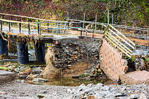 Low Bridge End Farm in St Johns in the Vale, near Keswick, Lake District, UK, with access bridge destroyed by the floods from Storm Desmond. England, UK, December 2015. - Ashley Cooper