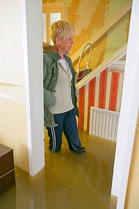 Resident inside flooded house, Toll Bar near Doncaster, South Yorkshire, England, UK, 28th July 2007.  -  Ashley Cooper
