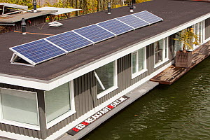 Floating house bed and breakfast with solar panels, Amsterdam, Netherlands, April 2013.  -  Ashley Cooper