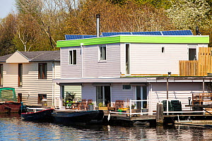 Floating house with solar panels in Amsterdam, Netherlands. May 2013.  -  Ashley Cooper