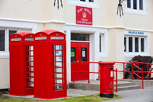 The Post Office with traditional red telephone boxes and postbox on Port Stanley the capital of the Falkland Islands. February 2014.  -  Ashley Cooper