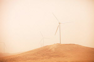 Wind farm seen through haze of a dust storm. Inner Mongolia, China, March 2009. - Ashley Cooper
